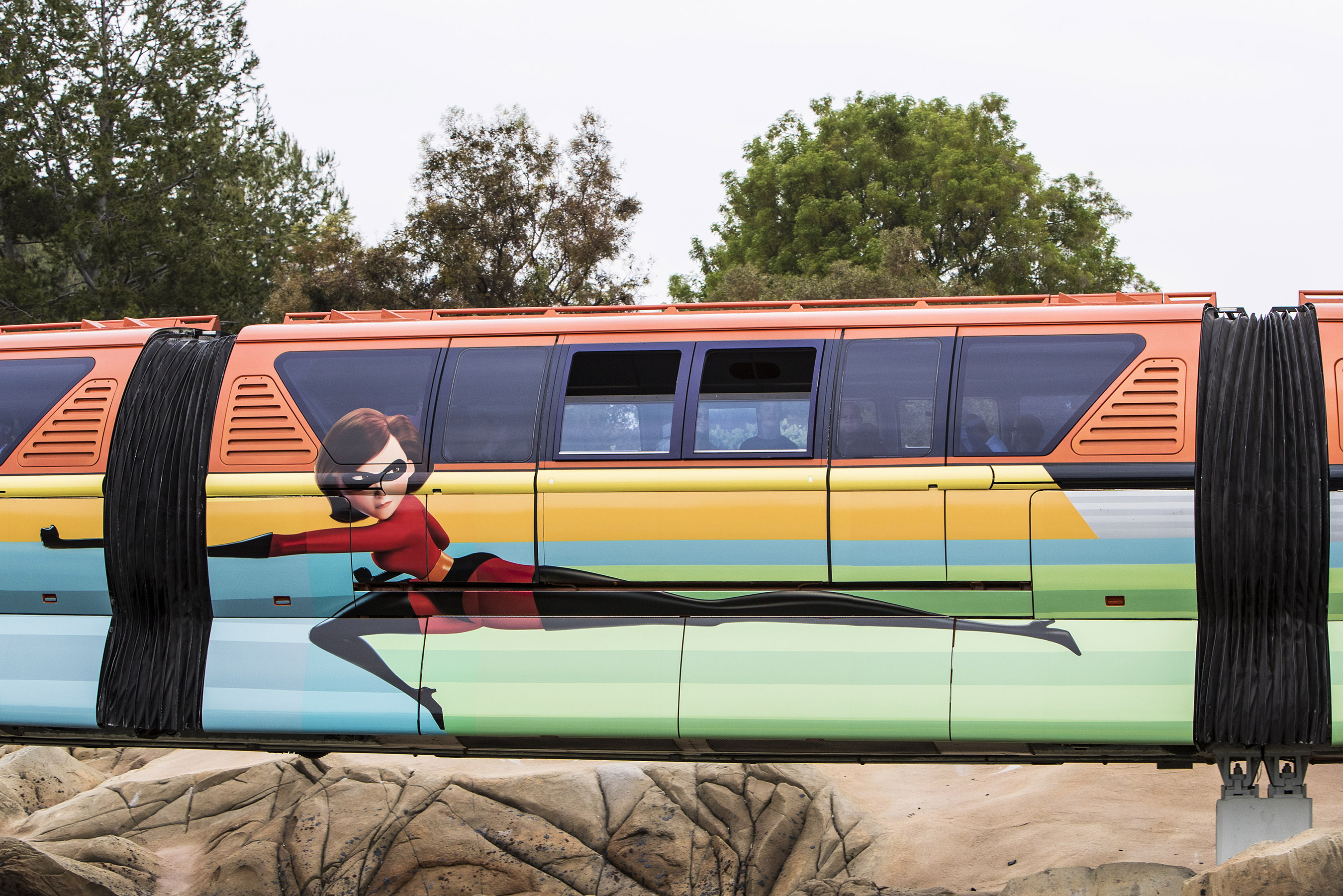 """PIXAR FEST AT THE DISNEYLAND RESORT (ANAHEIM, Calif.) - The Disneyland Monorail is zipping through the resort with a new Pixar-themed look to celebrate Pixar Fest! The orange train, inspired by Disney•Pixar's """"The Incredibles,"""" features Mr. Incredible, Mrs. Incredible, Violet, Dash and Jack-Jack on one side, while Frozone makes a cool splash on the other. Pixar Fest, the biggest Pixar celebration ever to come to Disney Parks, brings guests together to celebrate friendship and beyond at the Disneyland Resort from April 13 through Sept. 3, 2018. (Joshua Sudock/Disneyland Resort)"""