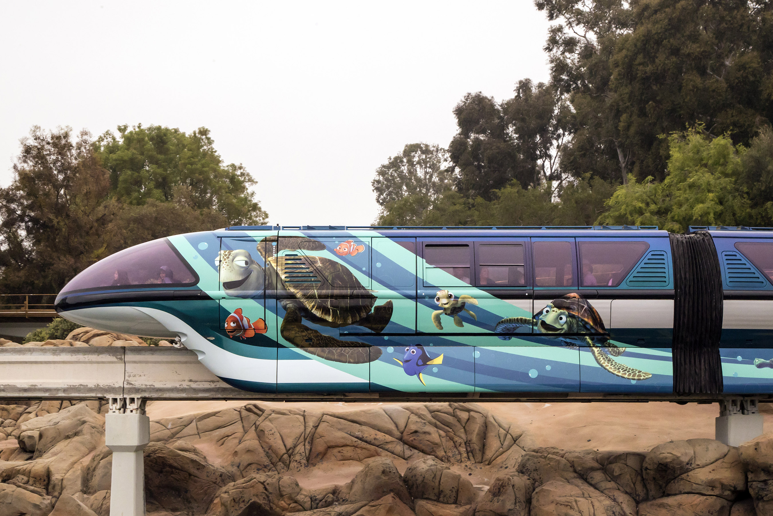 """PIXAR FEST AT THE DISNEYLAND RESORT (ANAHEIM, Calif.) - The Disneyland Monorail is zipping through the resort with a new Pixar-themed look to celebrate Pixar Fest! The blue train, inspired by Disney•Pixar's """"Finding Nemo,"""" features Crush and Squirt surfing alongside pals Nemo and Dory. Pixar Fest, the biggest Pixar celebration ever to come to Disney Parks, brings guests together to celebrate friendship and beyond at the Disneyland Resort from April 13 through Sept. 3, 2018. (Joshua Sudock/Disneyland Resort)"""