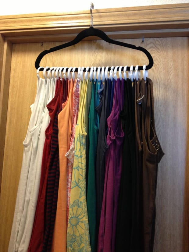 Hang your tank tops with only one hanger and shower curtain rings