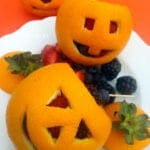 Orange Jack-O-Lanterns Filled with Fruit