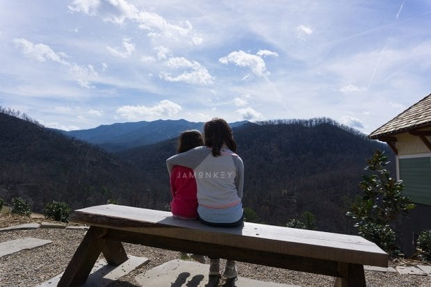 Sister hugging and looking at the mountains