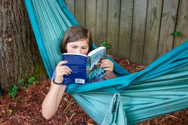 Girl reading Percy Jackson