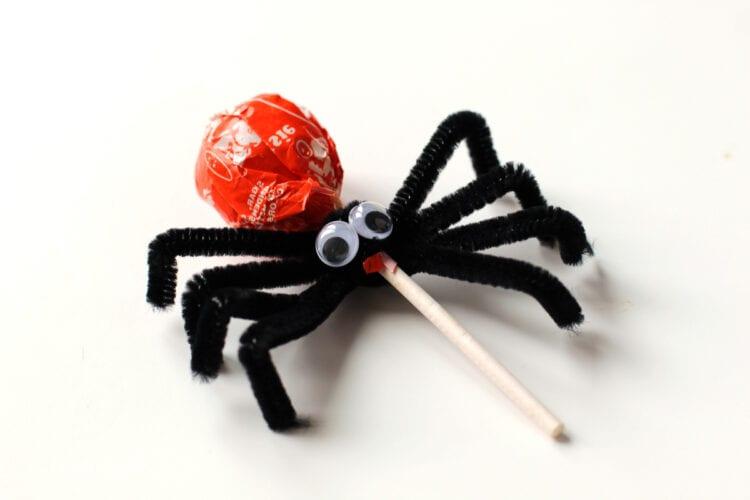 Glue googly eyes to lollipop