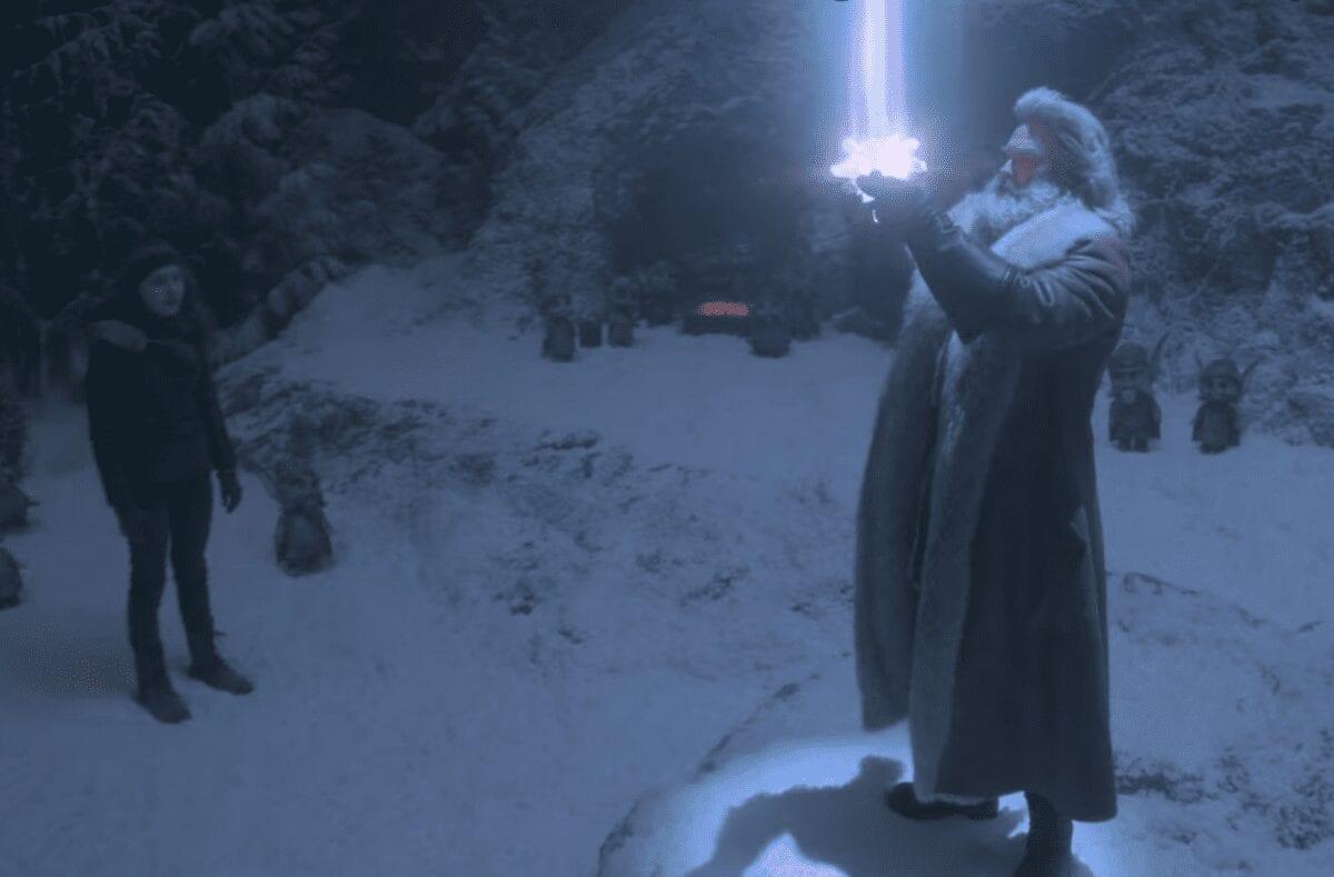 Santa holding the star of Bethlehem