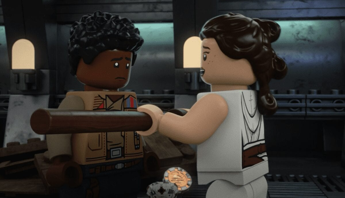 LEGO Rey hands LEGO Finn the wooden lightsaber Holiday Special