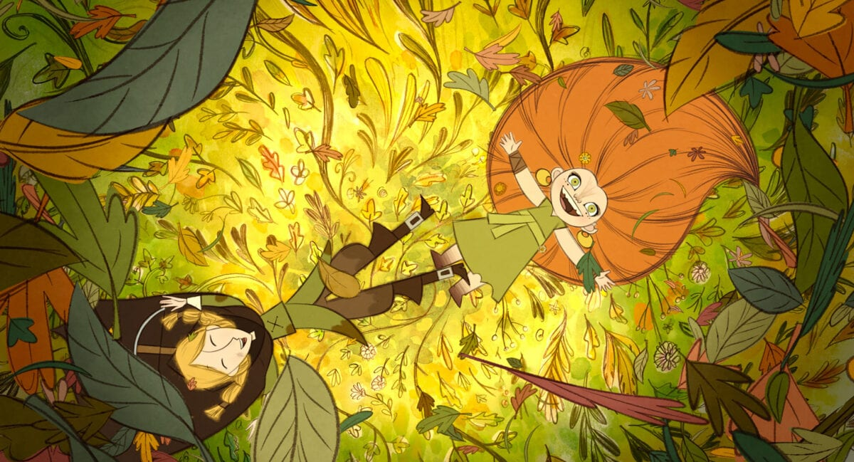 Wolfwalkers Robyn (left) and Mebh (right) lay on a bed of leaves.