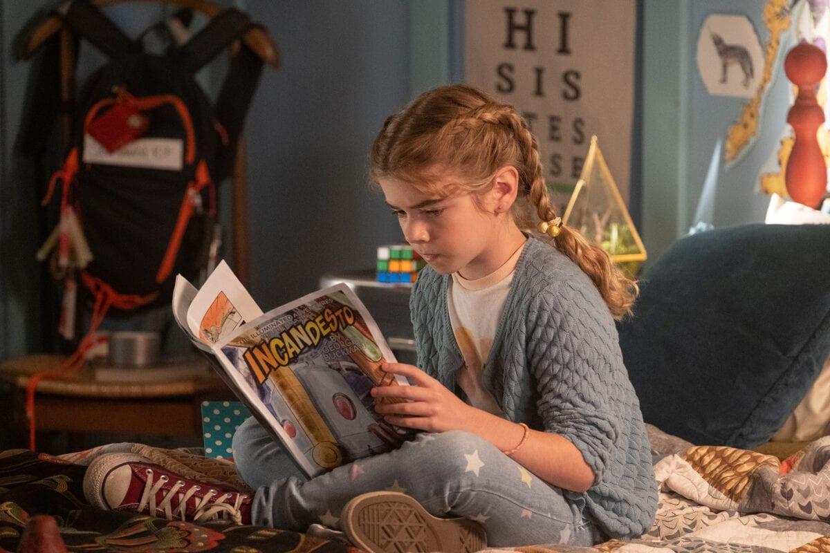 Flora reading an Incandesto comic book.